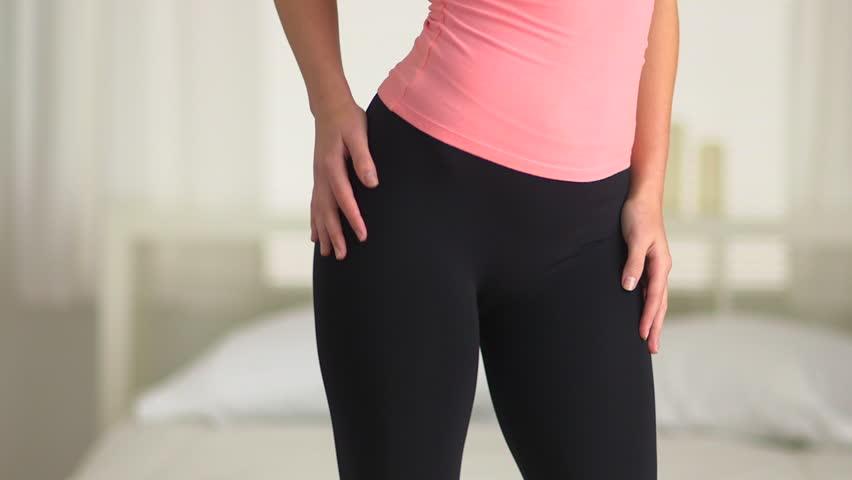 Young Woman Dancing In Yoga Pants