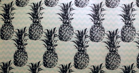 Pineapples stamped on wallpaper