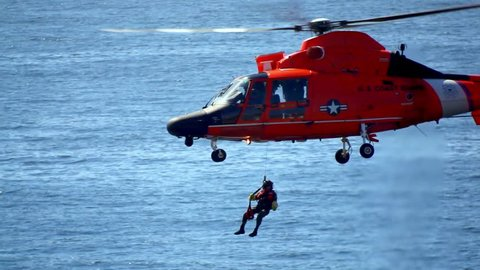 LOS ANGELES, CALIFORNIA, USA - JUNE 20, 2016: US Coast Guard Helicopter Performing Rescue Mission