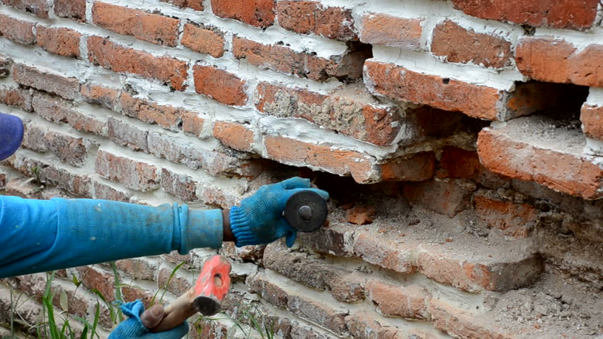 Worker removing of brick for repairing  | Shutterstock HD Video #35023807