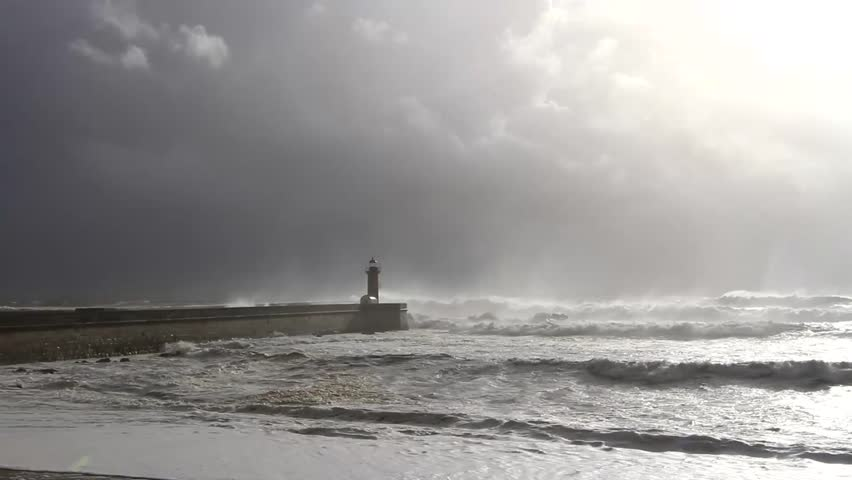storm in the city of Porto. Portugal. old lighthouse