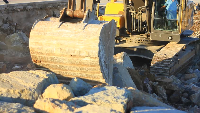 Excavator operating in a rock quarry. Hydraulic excavator works for formation of