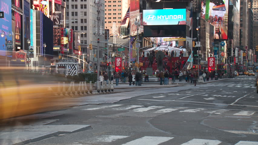 NEW YORK - MARCH 10: (Time-lapse) Vehicular and pedestrian traffic move through Times Square at the intersection of 7th Avenue and 45th Street on March 10, 2013 in New York.