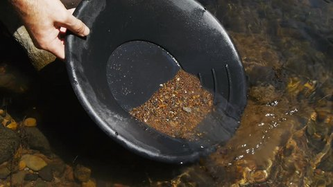 close up of washing gravel from a gold pan