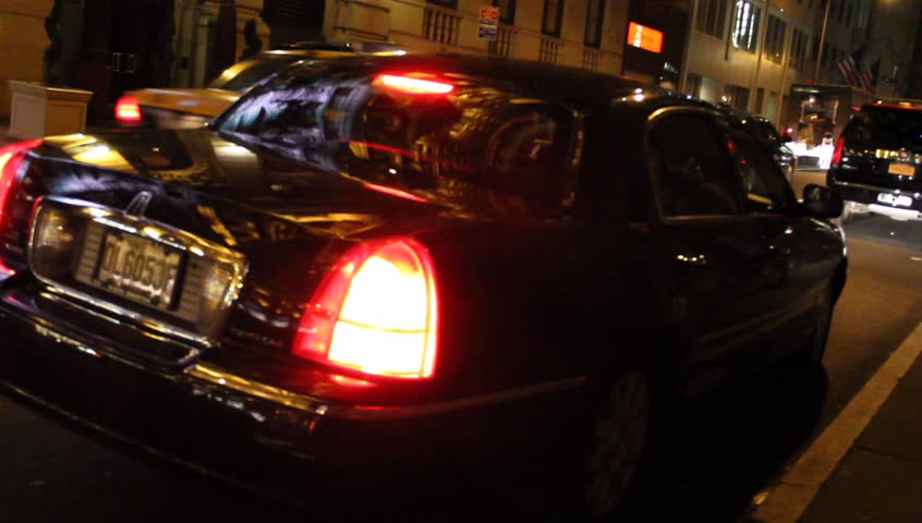 New York, NY - Circa 2012: Limousine in NYC at night Pulling out