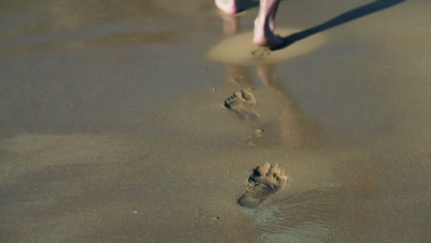 Footprints on the beach left behind, , slow motion shot at 480fps