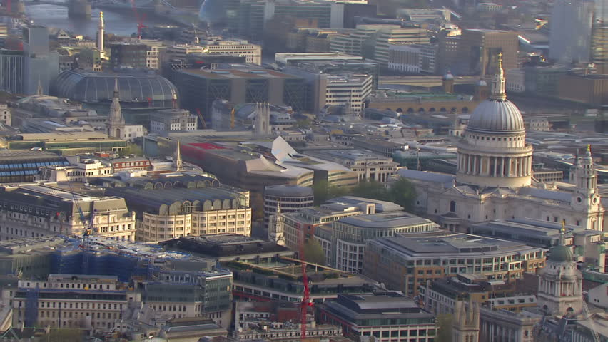 Aerial view over London and St. Paul's Cathedral. The river Thames can be seen in the background