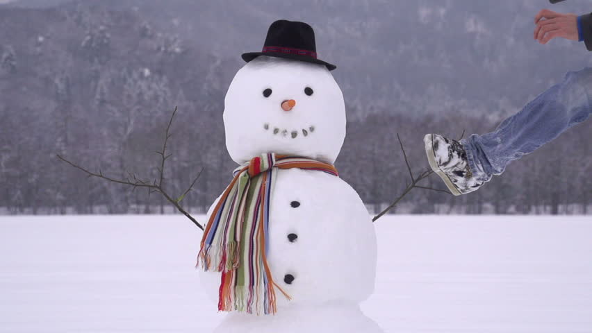 Man destroying a snowman slow motion