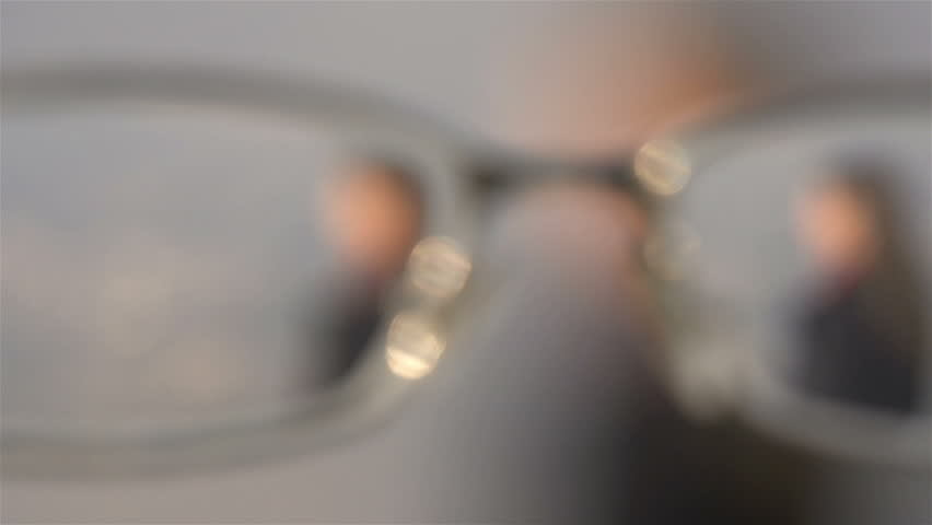 FIRST PERSON VIEW: Putting on glasses | Shutterstock HD Video #3579857