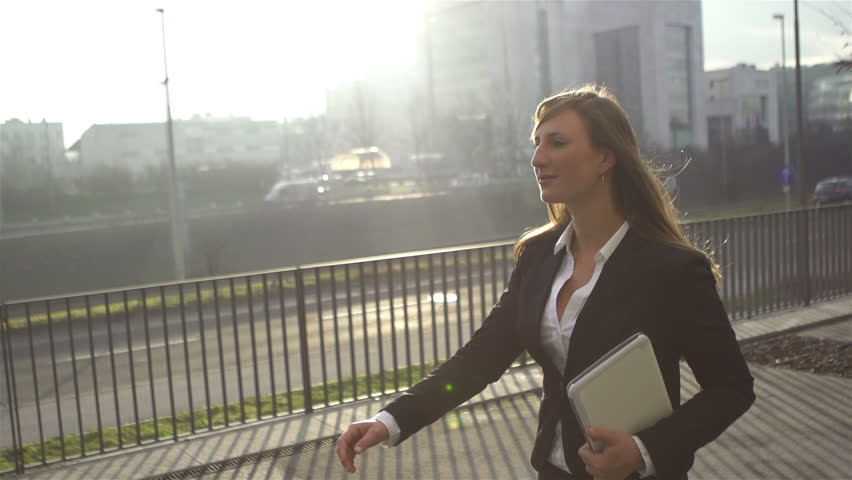 SLOW MOTION: Young businesswoman going to work in the morning