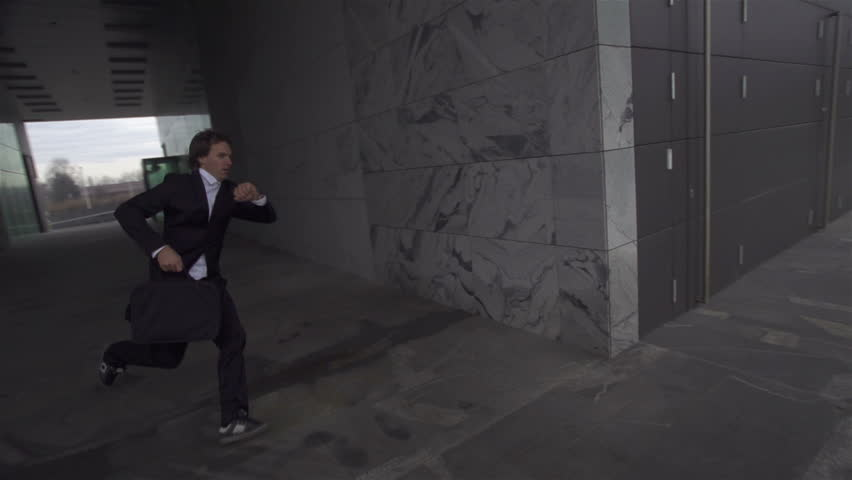SLOW MOTION: Late businessman is running to a meeting | Shutterstock HD Video #3580211