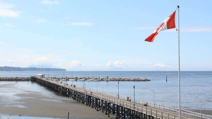 White Rock Pier and Beach, British Columbia. White Rock beach and the pier that leads out to it's marina. White Rock beach is close to the US/Canada border on British Columbia's coast. Canada.