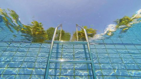 Pool stairs view from underwater slow motion