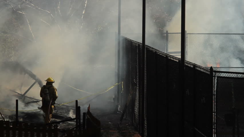 Firefighters extinguishing fire at daycare