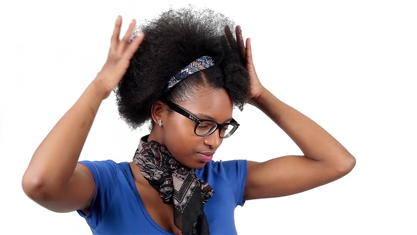 Happy african american woman shows her afro hair style, over white background