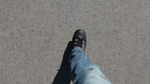 Walking in jeans and sport shoes on different winter city grounds