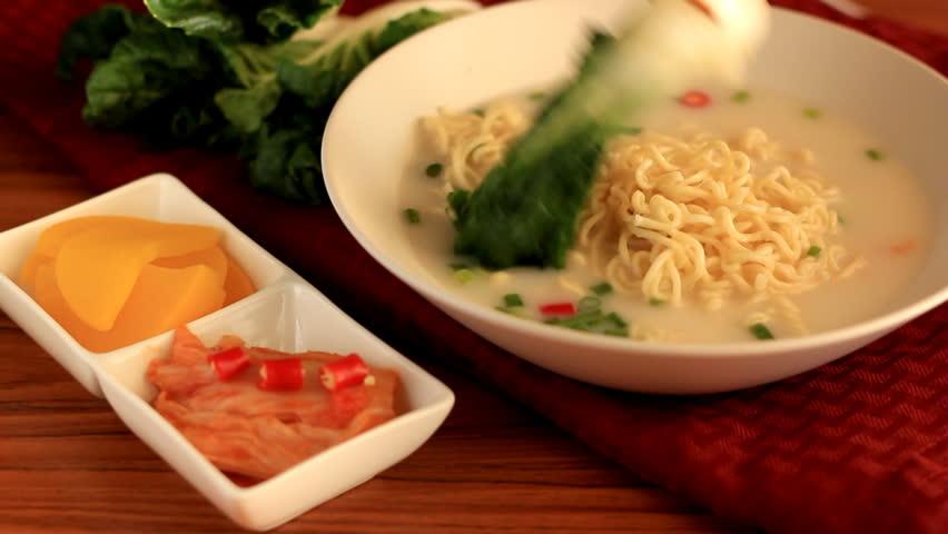 Decoration the noodles. The Japanese seaweed kimchi radish and lettuce.