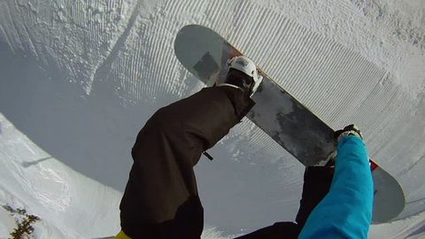 FIRST PERSON VIEW: snowboarder jumps frontside 360