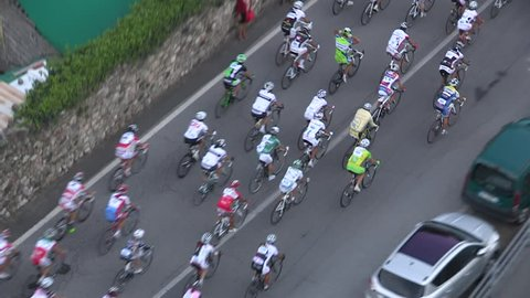 Pack of cyclists taking the lead at the head of a race