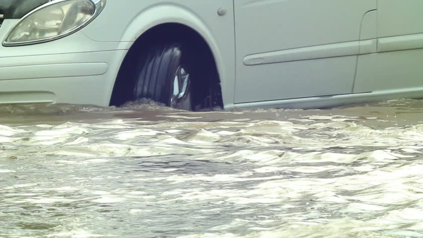 Flooded road after heavy rains,cars moving slowly in deep waters. vehicle sequence.  | Shutterstock HD Video #3636773