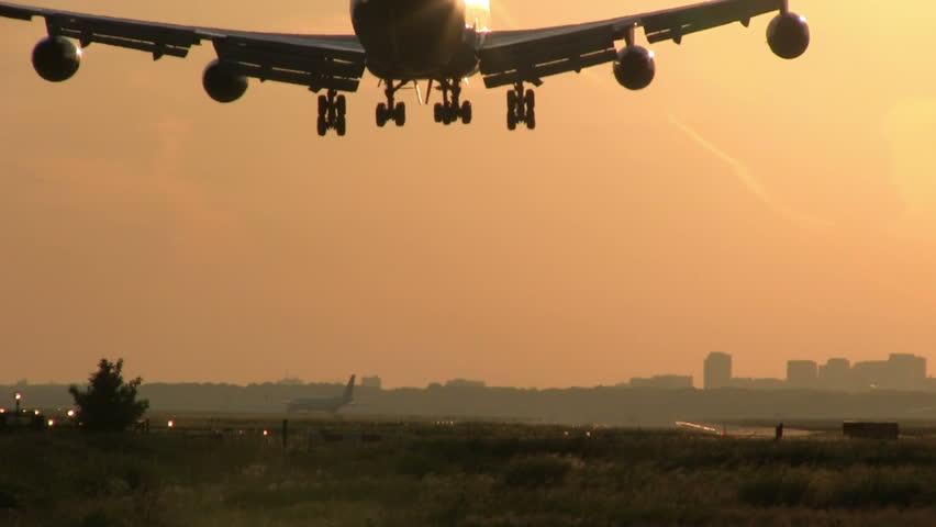 Jumbojet landing at sunrise