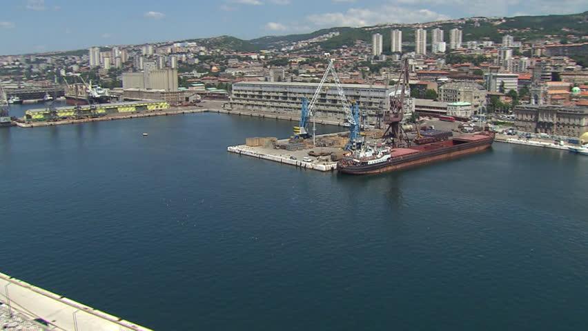 Aerial shot of a cargo ship docked in the port of Rijeka | Shutterstock HD Video #3657257
