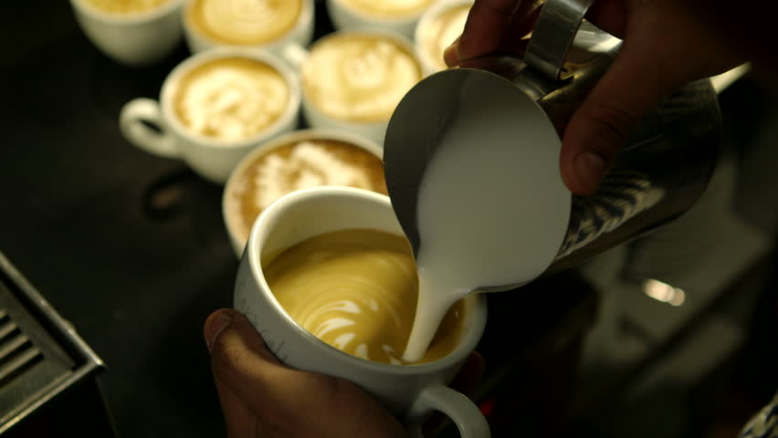 Barista makes pattern in coffee     | Shutterstock HD Video #3660287