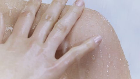 Young woman taking a shower in slow motion