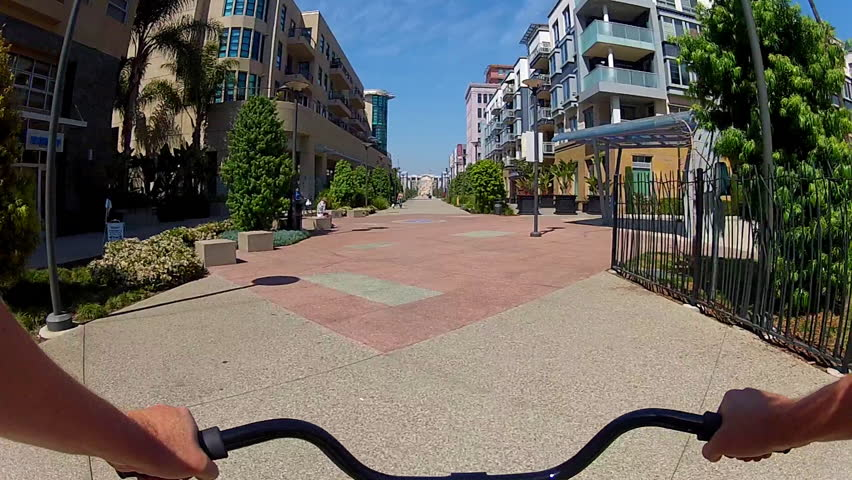 LONG BEACH, CA - APRIL 2, 2013: The POV of someone riding a bicycle on The Promenade circa 2013 in downtown Long Beach. Long Beach promotes bike riding and being a bicycle friendly city.
