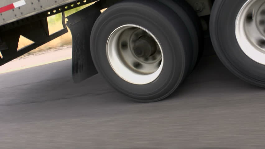 Truck tire wheels, close up, travel highway. 1080p