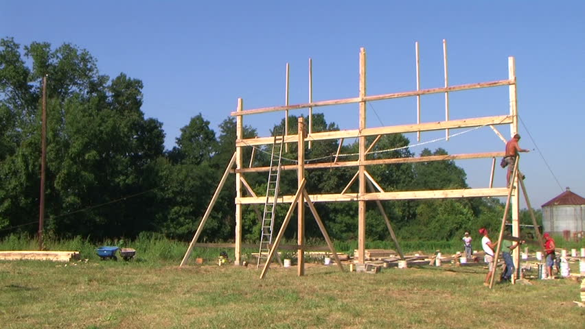 Time lapse of carpenters building barn.
