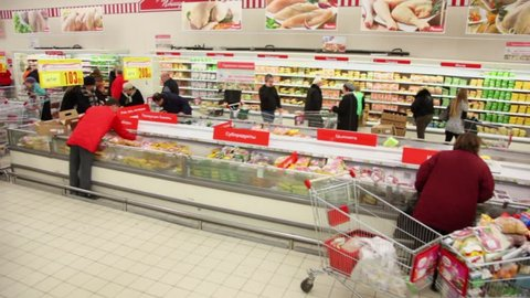 MOSCOW - DEC 9: People buy food at Auchan store in shopping center Troika, shown in motion on december 9, 2011 in Moscow, Russia. Auchan revenue in Russia totaled 205.147 billion rubles in 2011