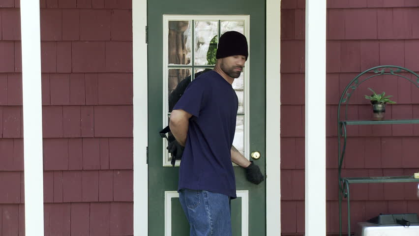 Burglar makes his way up to a house door, finds it unlocked and makes his way
