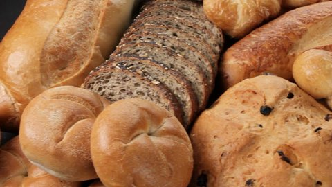 Breads and baked goods: Camera pans across large assortment in HD video