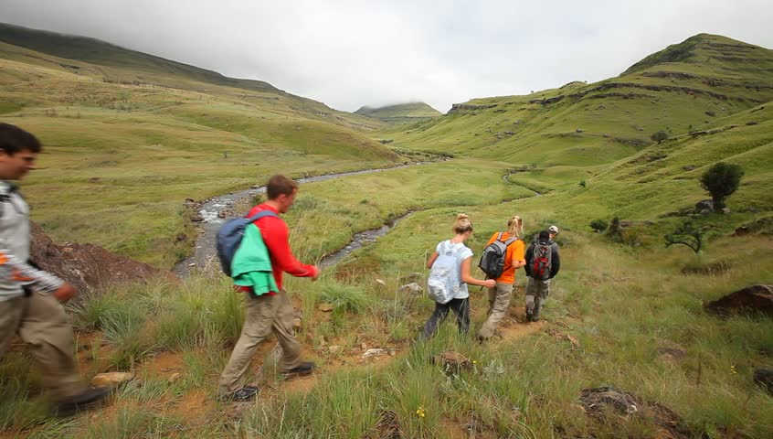 Young group hiking in the Drakensberg,  the highest mountain range in Southern Africa | Shutterstock HD Video #3709769