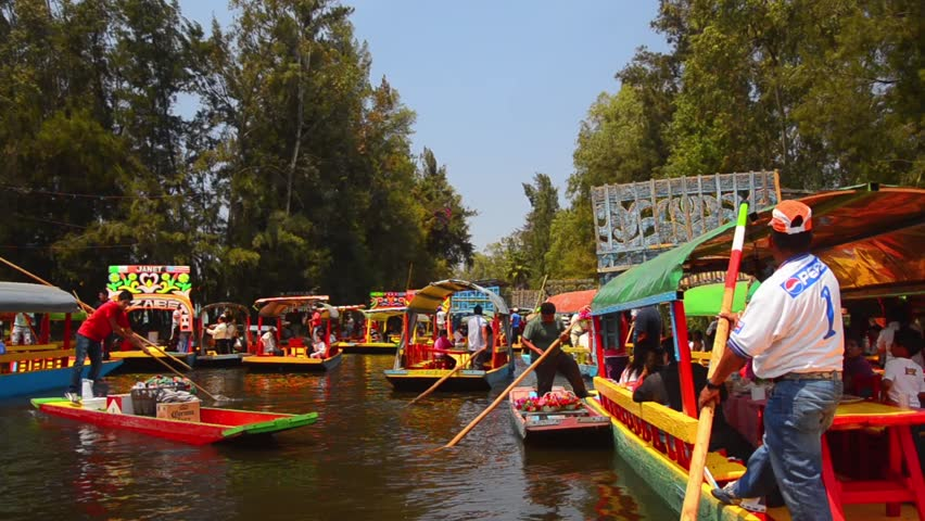 MEXICO CITY - MARCH 24 - Colorful boats float down the Xochimilco canal on March 24, 2013.  Xochimilco canal is popular place for locals and tourists alike to relax.