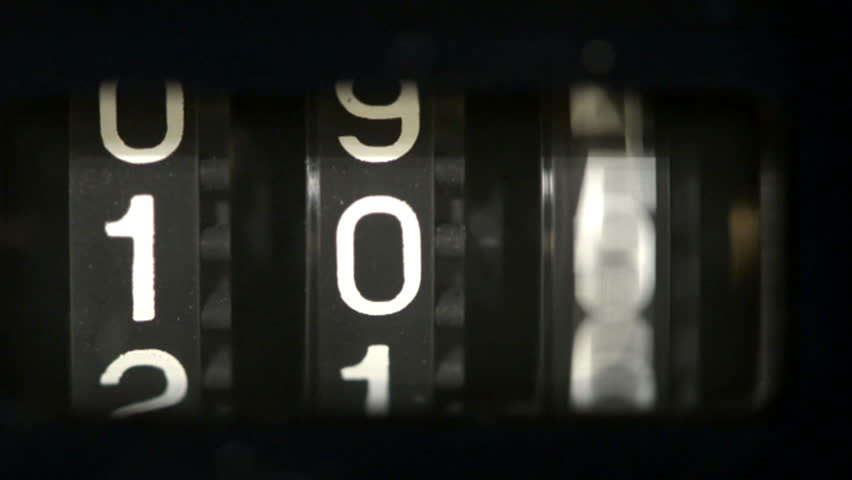 Close up to a mechanical counter counting down from 105 to 000