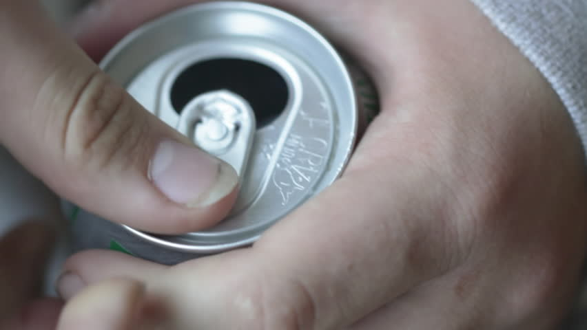 65b6cad75e Teenage hands open a can of soda. Shot with a macro lens and shallow depth