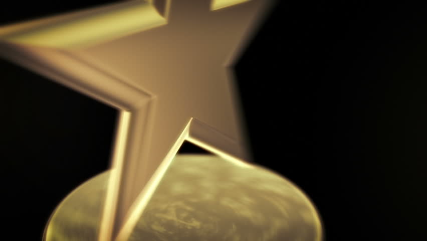 Gold Star Award - Spinning award statue in gold, ideal for any award ceremony with copy space at the end to put your own text or logo. | Shutterstock Video #3735872