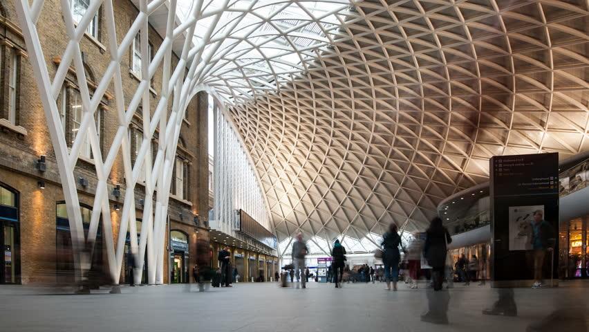 LONDON - APRIL 13: People walking inside King's Cross railway station on April 13, 2013 in London, UK. The annual rail passenger usage between 2011 - 2012 was 27.874 million.