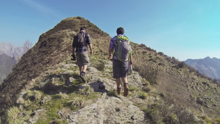 Young Couple Walking in the Mountains | Shutterstock HD Video #3761249
