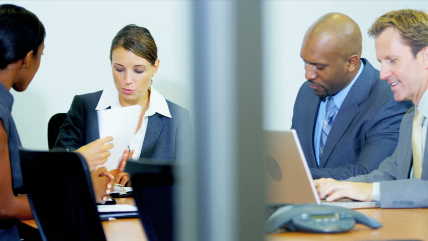 Team smart multi ethnic financial traders using wireless technology in planning meeting shot on RED EPIC | Shutterstock HD Video #3766877