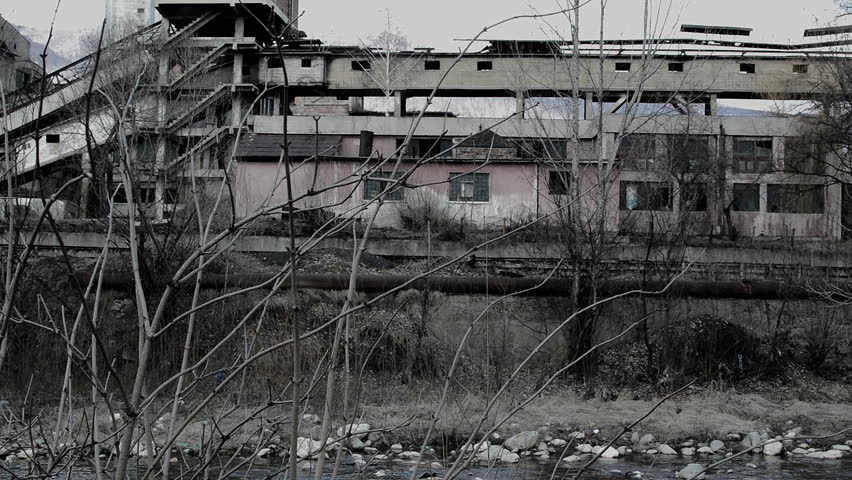 abandoned industrial building in post apocalyptic looking area
