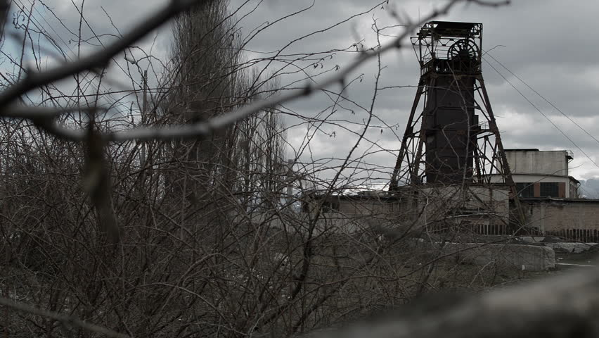 Old abandoned coal mine in post apocalyptic looking area