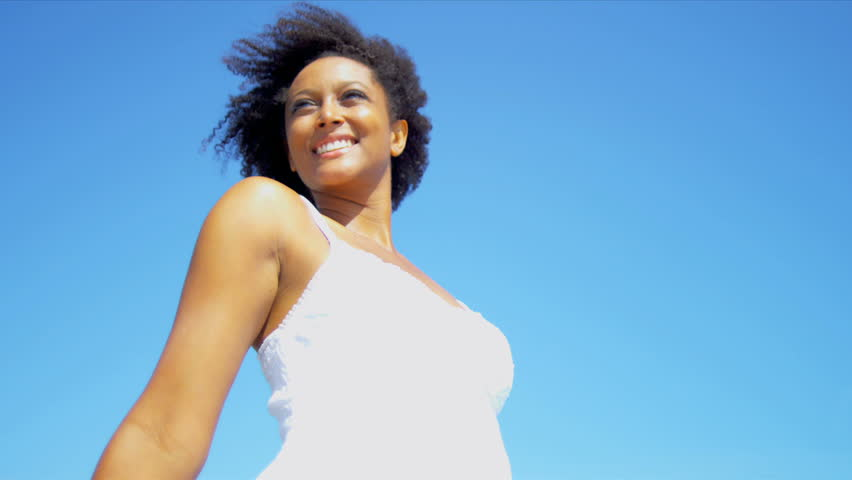 Head shoulders smiling ethnic girl in white dress on beach shot on RED EPIC
