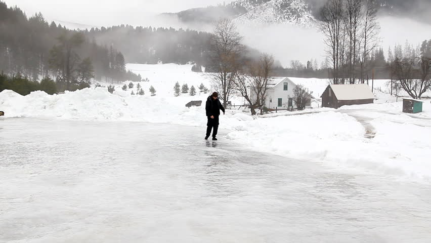 Man slipping on ice on a ranch in Montana | Shutterstock HD Video #3775817