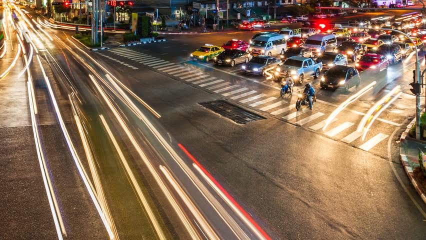 Traffic at crossing - Night time lapse in Bangkok