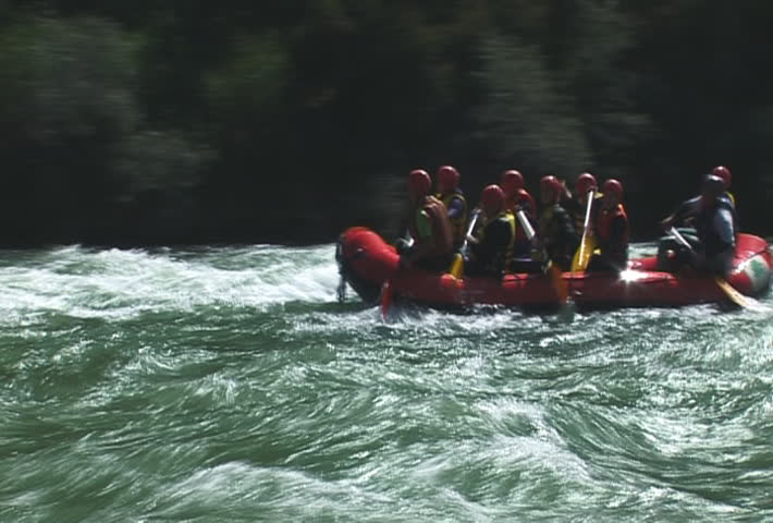 The Rubber raft with tourist on mountain river.