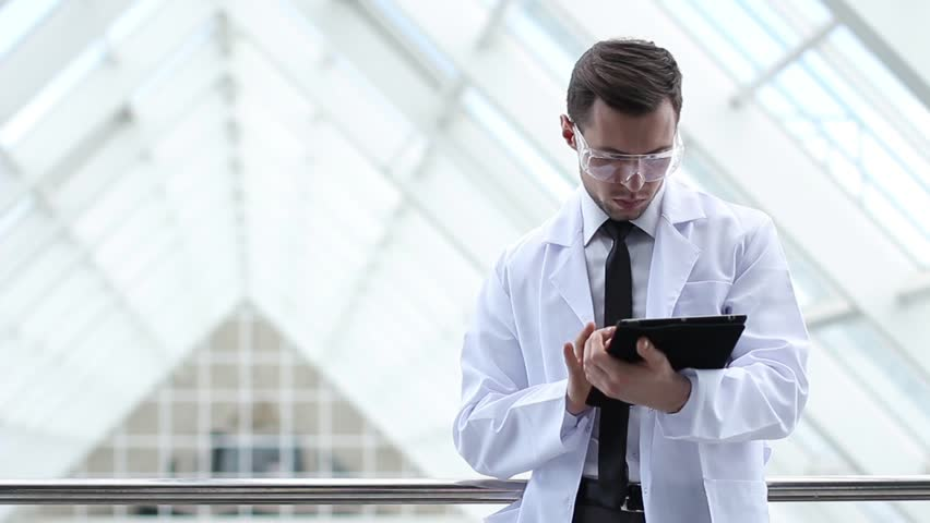scientist hands working on tablet computer