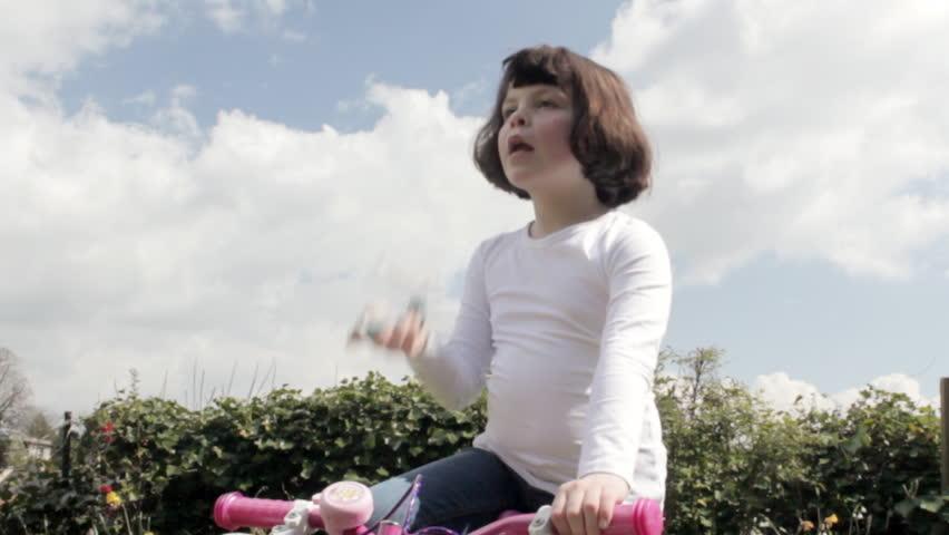 Little girl using asthma inhaler